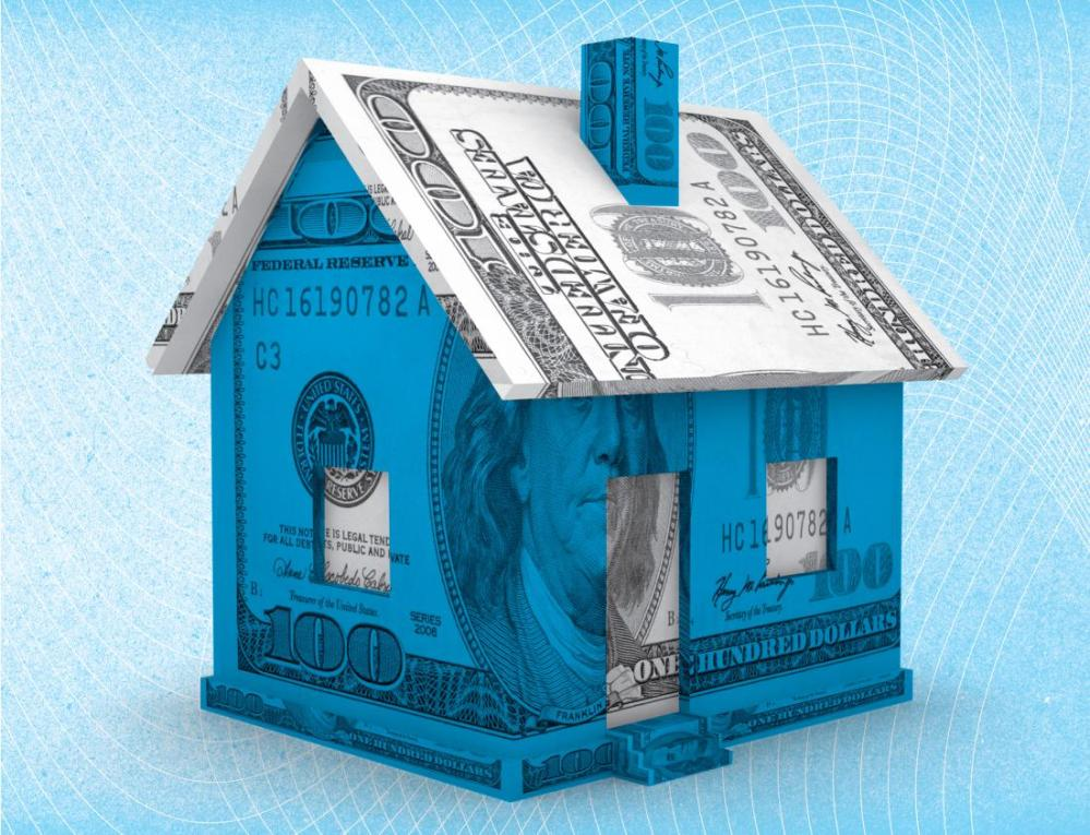 image: miniature house encased in 100 dollar bill